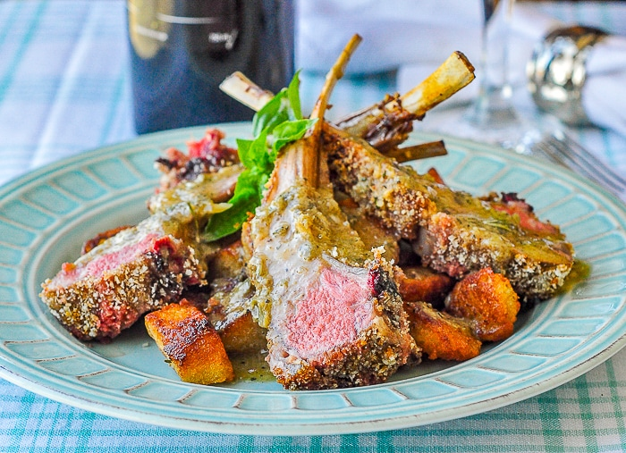 Parmesan Panko Crusted Rack of Lamb wide shot of a serving presented on a teal coloured dinner plate