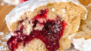 Raspberry Filled Donut Muffins close up photo of one muffin split in half to reveal filling