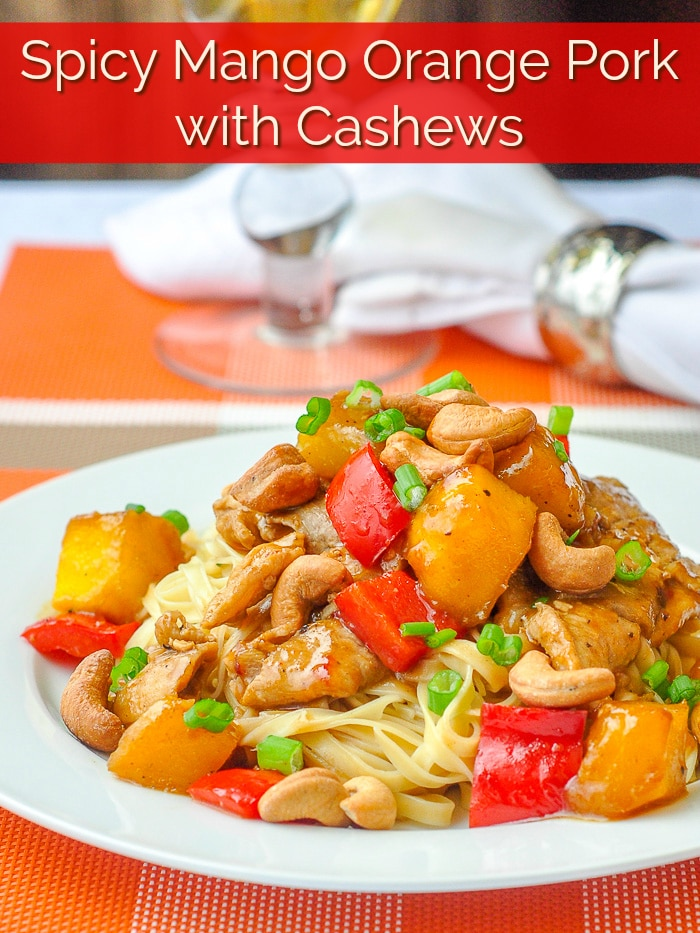 Spicy Mango Orange Pork with Cashews image with title text for Pinterest