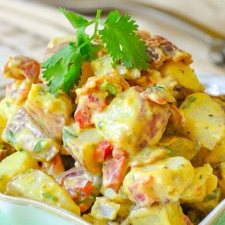 Bacon Potato Salad with Sweet Mustard Dressing close up photo of salad in a serving bowl
