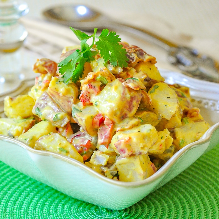 Bacon Potato Salad with Sweet Mustard Dressing in a cream coloured serving bowl
