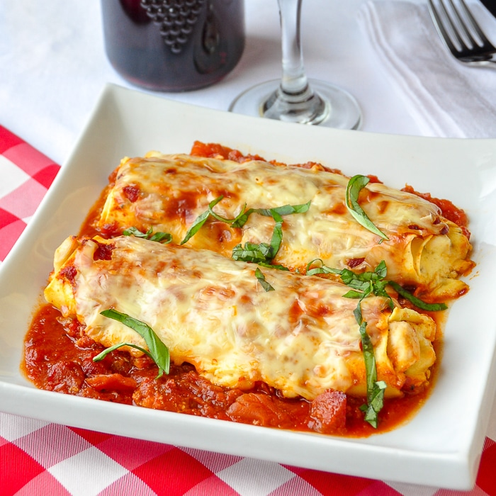 Chicken Cannelloni Margherita featured image on white plate.