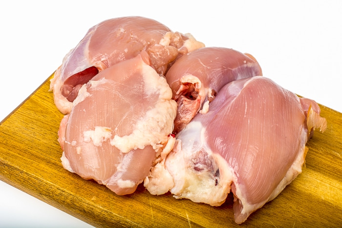 Raw chicken thigh meat. Stock Photo