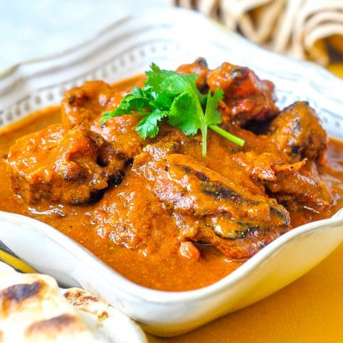 Low Fat Tomato Tandoori Chicken Curry. close up featured square image
