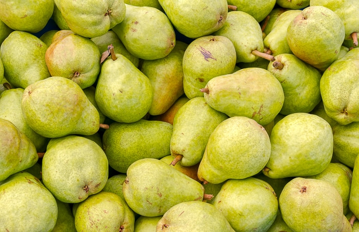 Freshly picked green Bartlett pears on display at the farmer's market