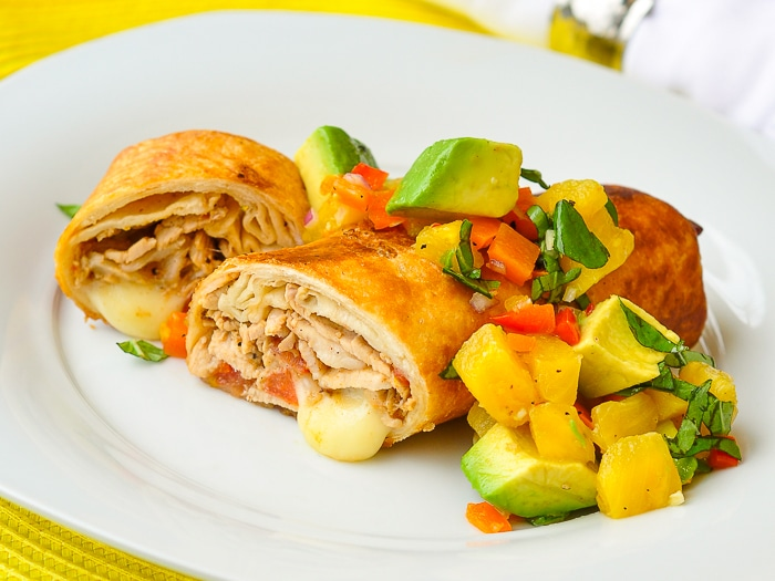 Pork Chimichangas with Avocado Pineapple Salsa photo of a single serving shown on a white plate