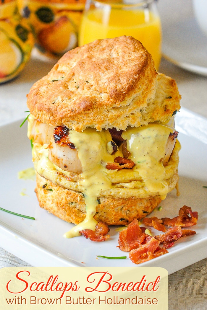 Scallops Benedict with crumbled bacon on a white plate with title text added for Pinterest
