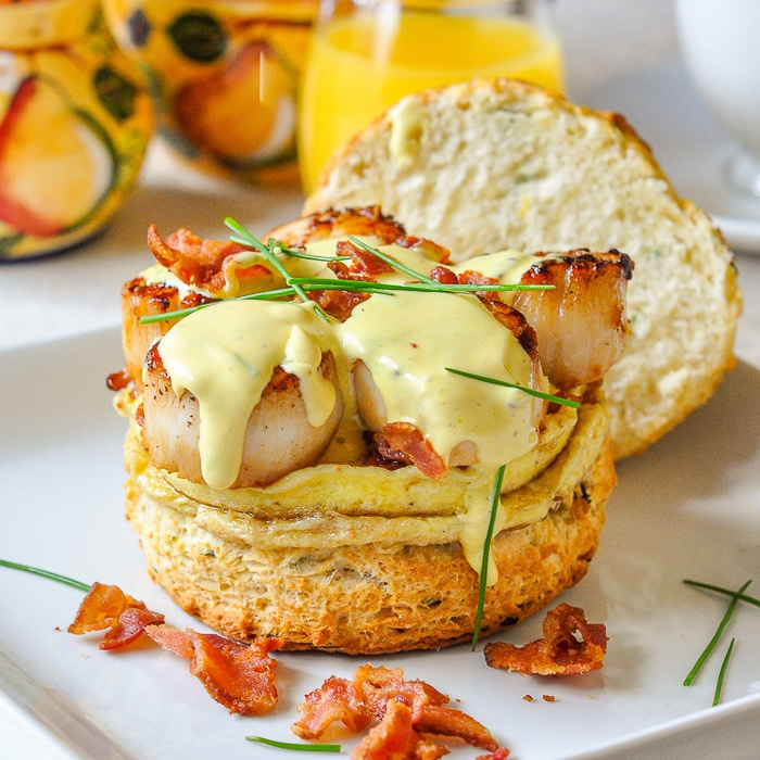 Scallops Benedict with egg and crumbled bacon on a buttermilk Biscuit