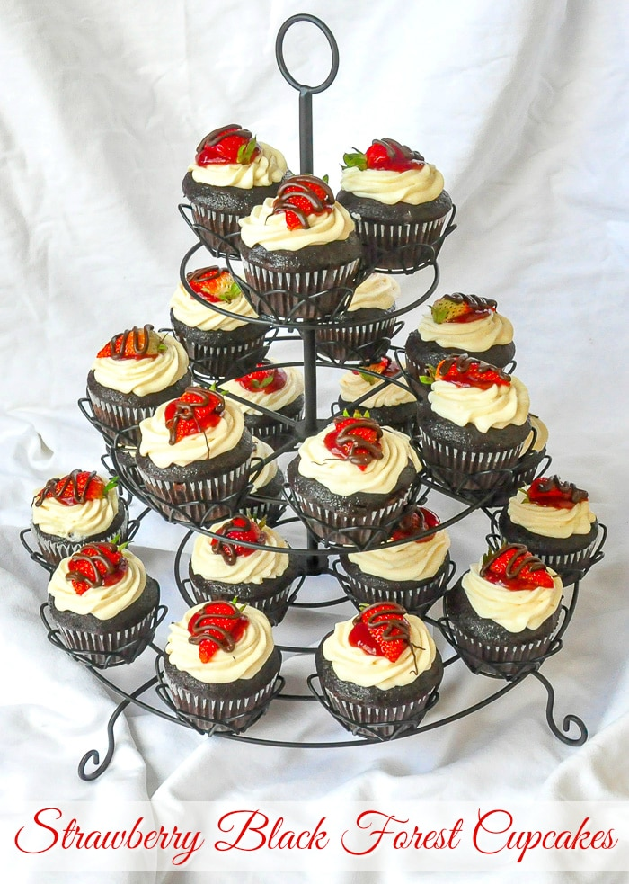 Strawberry Black Forest Cupcakes on a cupcake stand with title text added for Pinterest
