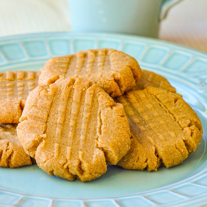 3 Ingredient Gluten Free Peanut Butter Cookies on a teal coloured plate