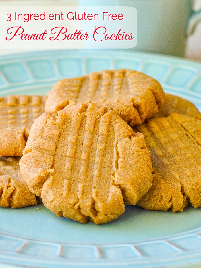 3 Ingredient Gluten Free Peanut Butter Cookies photo of cookies on a teal coloured plate with title text added for Pinterest