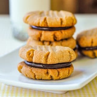 3 Ingredient Gluten Free Peanut Butter Cookies shown with chocolate filling on a white plate
