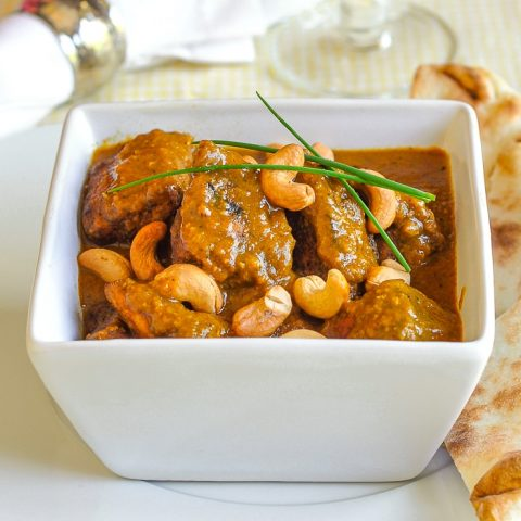 Easy Chicken Korma pictured in a white serving bowl