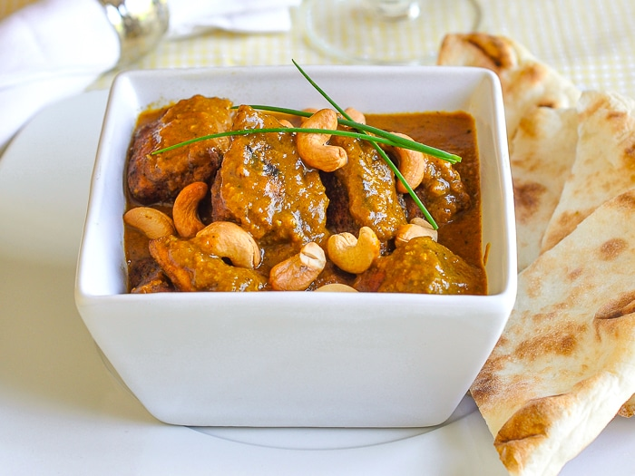 Easy Chicken Korma shown with naan on the side.