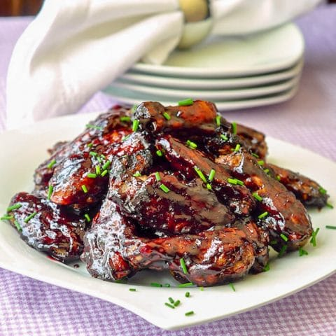 Honey Blueberry Barbecue Wings on a white serving platter