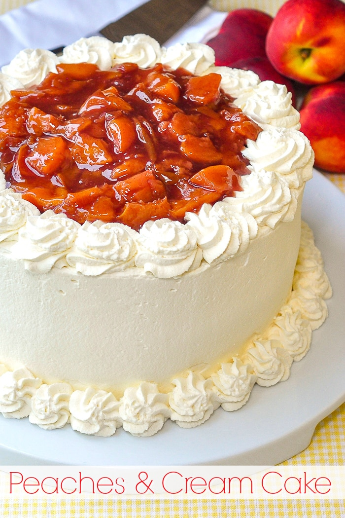 Roasted Peaches and Cream Cake photo of uncut cake with title text added for Pinterest