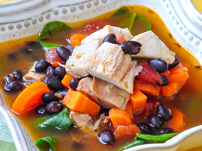 Barbecue Chicken Soup with black beans close up photo of soup in a bowl