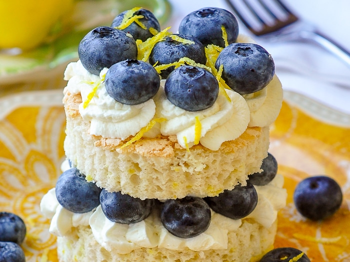 Lemon Berry Angel Food Shortcake close up image howing lightness of the cake crumb