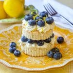 Lemon Berry Angel Food Shortcake featured square image, shown with blueberries on a yellow patterned serving plate.
