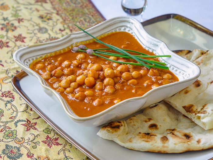 Easy Coconut Chick Pea Korma shown with naan