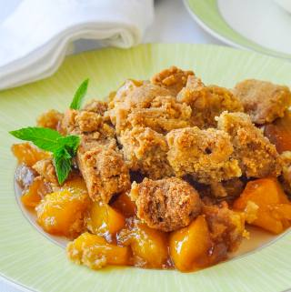 Mango Peach Coconut Crumble is an incredible combination of tropical and local flavours that combine to make one fantastic comfort food dessert. A scoop of good vanilla or coconut ice cream makes it even better.