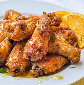 Baked Southern Fried Chicken Wings with Orange Honey Drizzle close up shot