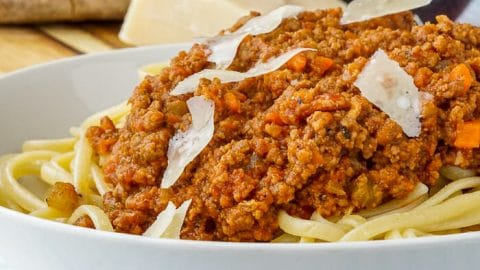 The Best Bolognese Sauce in bowl with linguine. Square image.