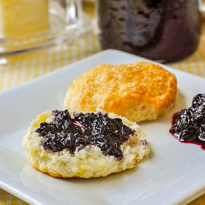 Sour Cream Lemon Scones close up photo spread with wild blueberry jam