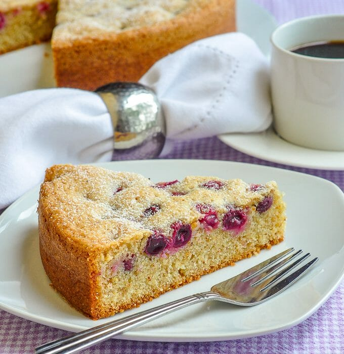 Sunken Grape Almond Cake single slice on white plate