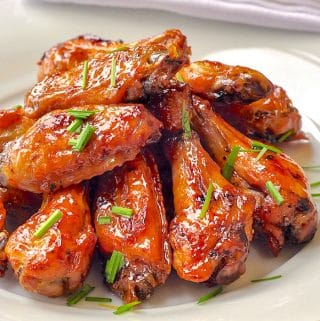 Brown Sugar Dijon Chicken Wings close up photo on white plate