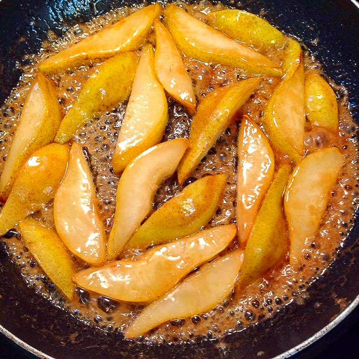 Caramelizing the pears for pear prosciutto pizza.