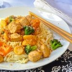 20 minute Honey Sriracha Chicken and Noodles close up photo of a single serving on a white plate