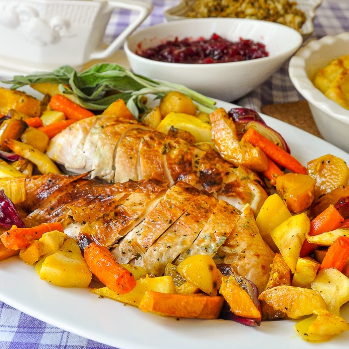 Lemon Sage Butter Roasted Turkey served with Maple Roasted Vegetables.