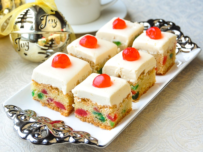 Cherry Cake Squares shown on a silver and white platter