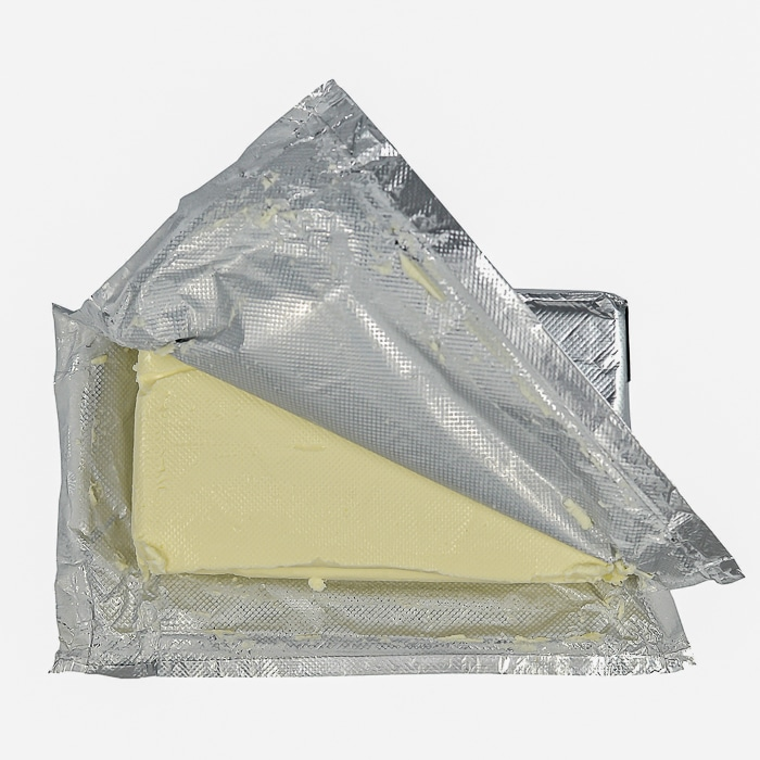 Stock photo of cream cheese in a foil package.