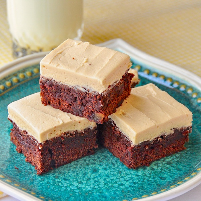 Gingerbread Brownies with Brown Butter Frosting close up photo on a green pattern plate
