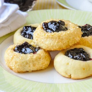 Lemon Blueberry Thumbprint Cookies close up photo on green and white plate