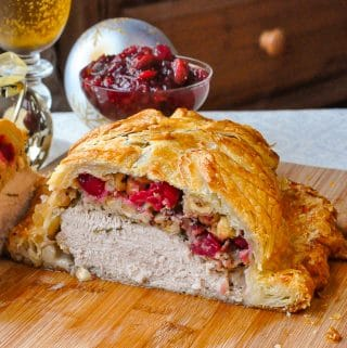 Cranberry Hazelnut Turkey Wellington close up photo of wellington cut open to reveal stuffing and turkey inside