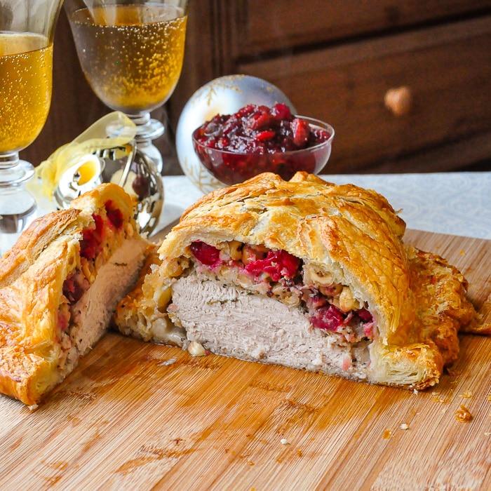 Cranberry Hazelnut Turkey Wellington cut open to reveal stuffing and turkey inside