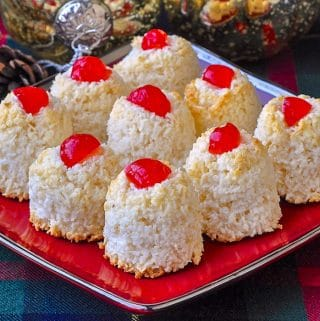 Haystack cookies close up image on red plate with christmas decorations in background