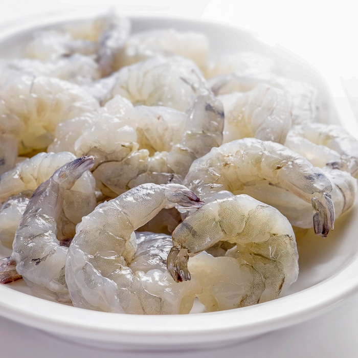 Raw shrimp in a white bowl