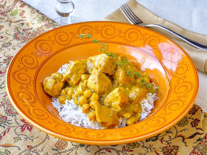 30 minute Easy Chicken Chickpea Curry wide shot of entire serving for one in orange pattern bowl