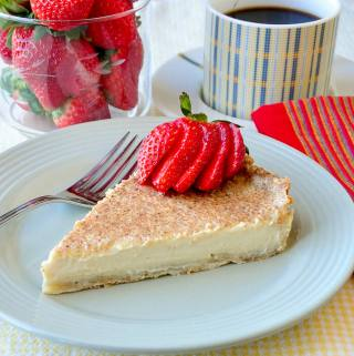 British Custard Tart, a rich creamy egg custard baked in a flakey pastry crust.
