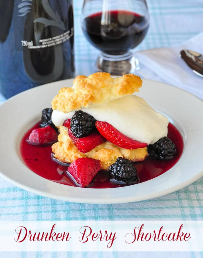 Drunken Berry Shortcake. Fresh berries are soaked in port wine for several hours or overnight before being served on homemade sweet biscuits with vanilla whipped cream.