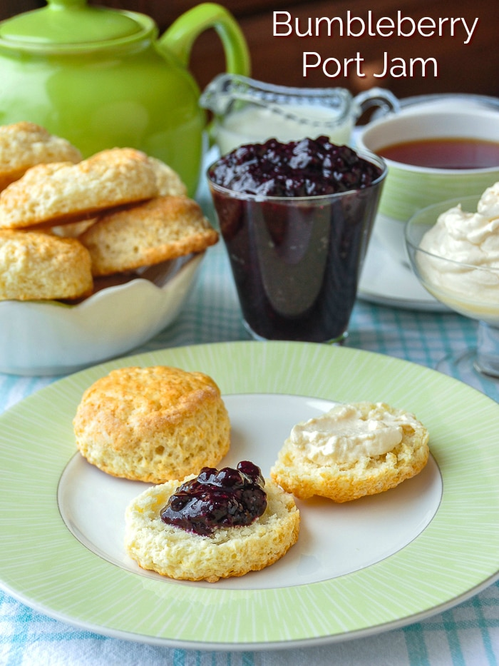 Bumbleberry Port Jam photo of jam with scones and cream with title text added for Pinterest