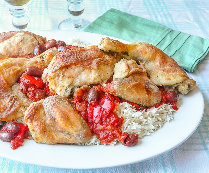 Chicken Cacciatore plated family style on a large white platter