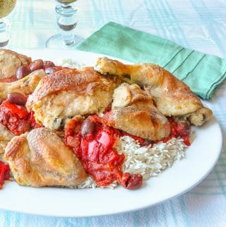 Chicken Cacciatore shown served with rice on a white platter