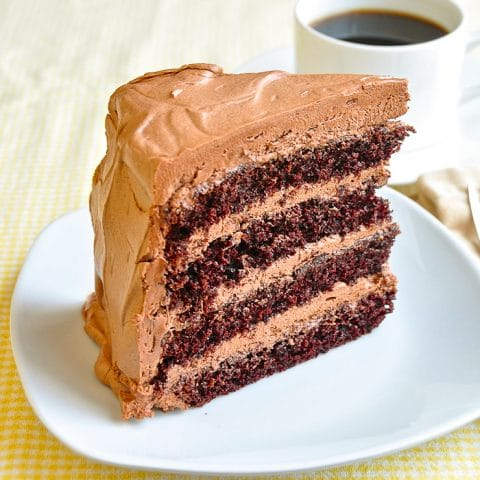 Chocolate Buttercream Frosting on a slice of 4 layer cake
