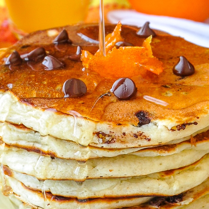Chocolate Chip Buttermilk Pancakes with Orange Infused Syrup close up image
