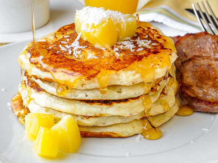 Pina Colada Pancakes close up photo with dripping syrup